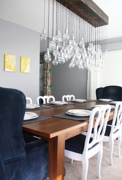 rustic wood table white chairs navy chairs gray walls