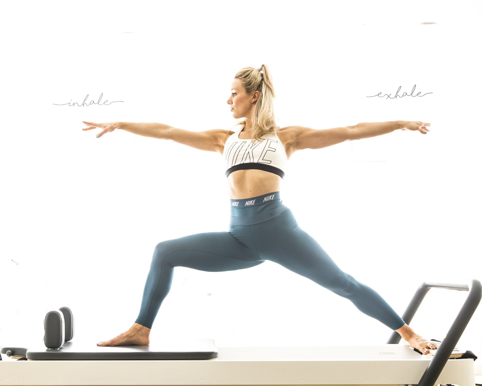 Trainer, Stefanie Turner, on the Pilates Reformer at