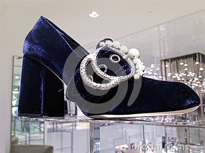 5eef0d304bb Miu Miu embellished blue velvet loafer pumps women shoes displayed at Saks  Fifth Avenue store in Toronto