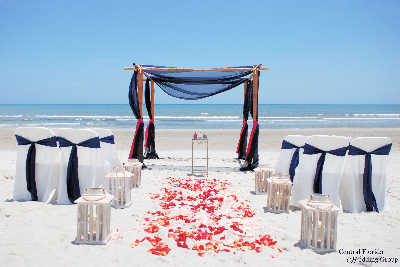 Beach wedding setup with 4post bamboo, navy blue sheers