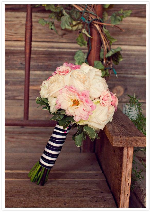 blush pinks and white rose bouquet with striped ribbon