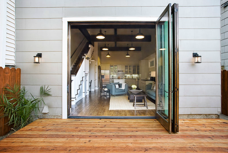 Suzie Sutro Architects Modern Deck Design With Folding Gl Patio Doors And Gray Siding
