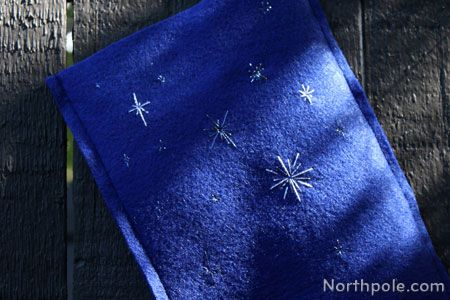 A Starry Night Stocking uses Kreinik thread to add sparkle to the sky.