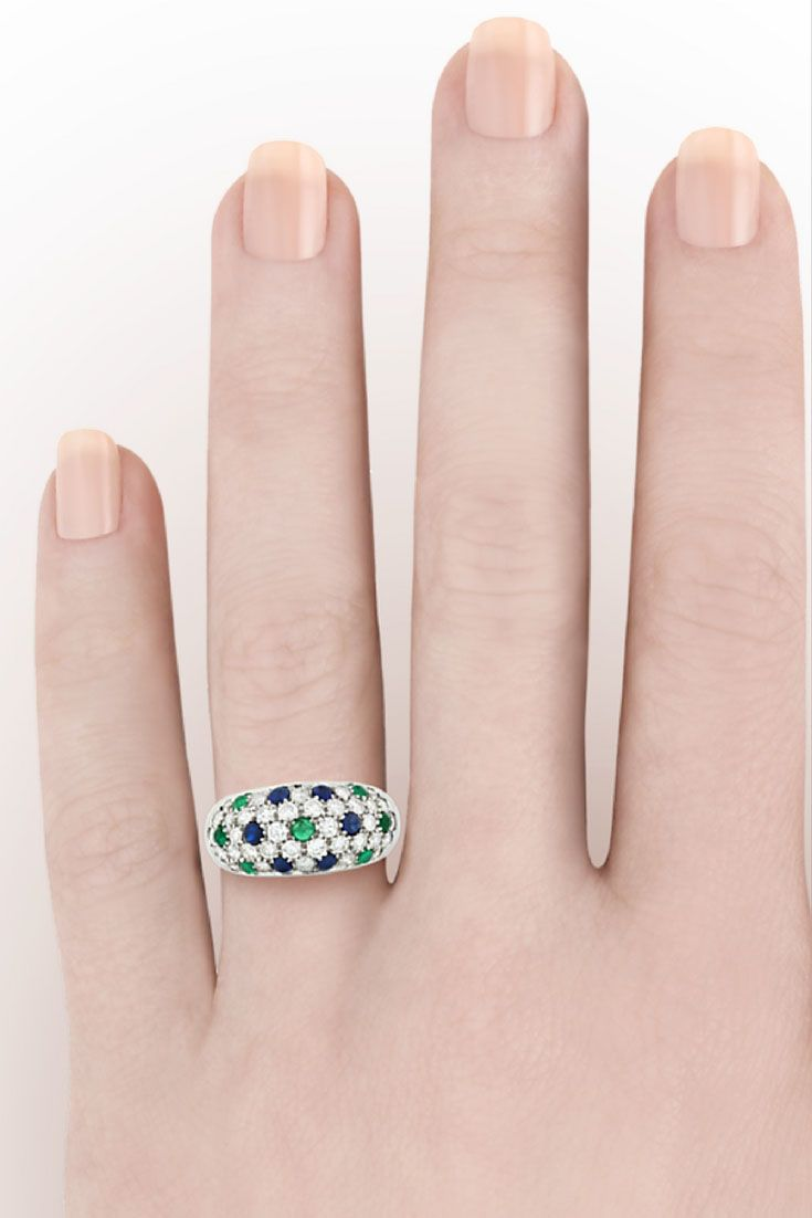 An array of emeralds, sapphires, and diamonds are embedded in this ...
