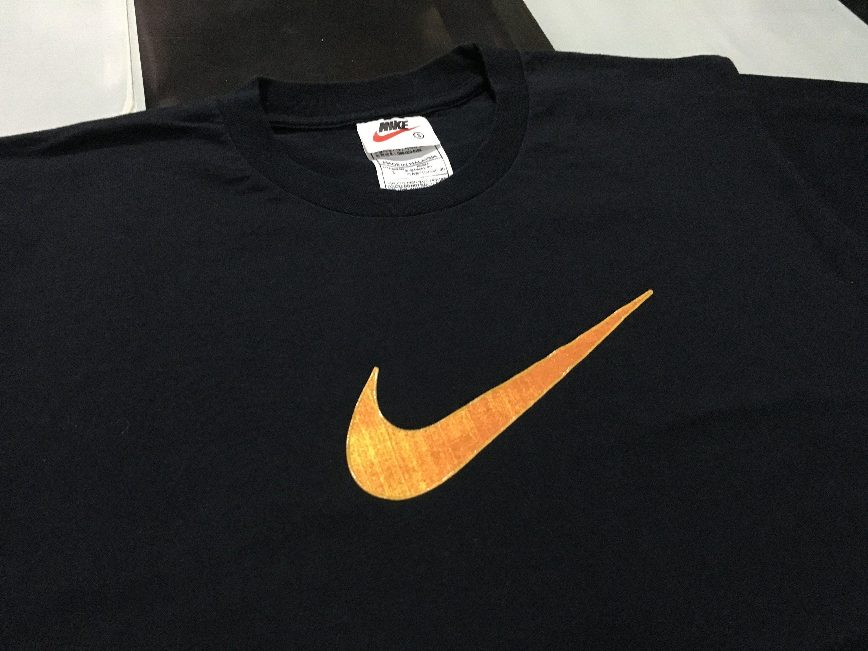 e69173721e1e6 Vintage Nike shirt Nike swoosh logo Black Orange Size S fits like M ...