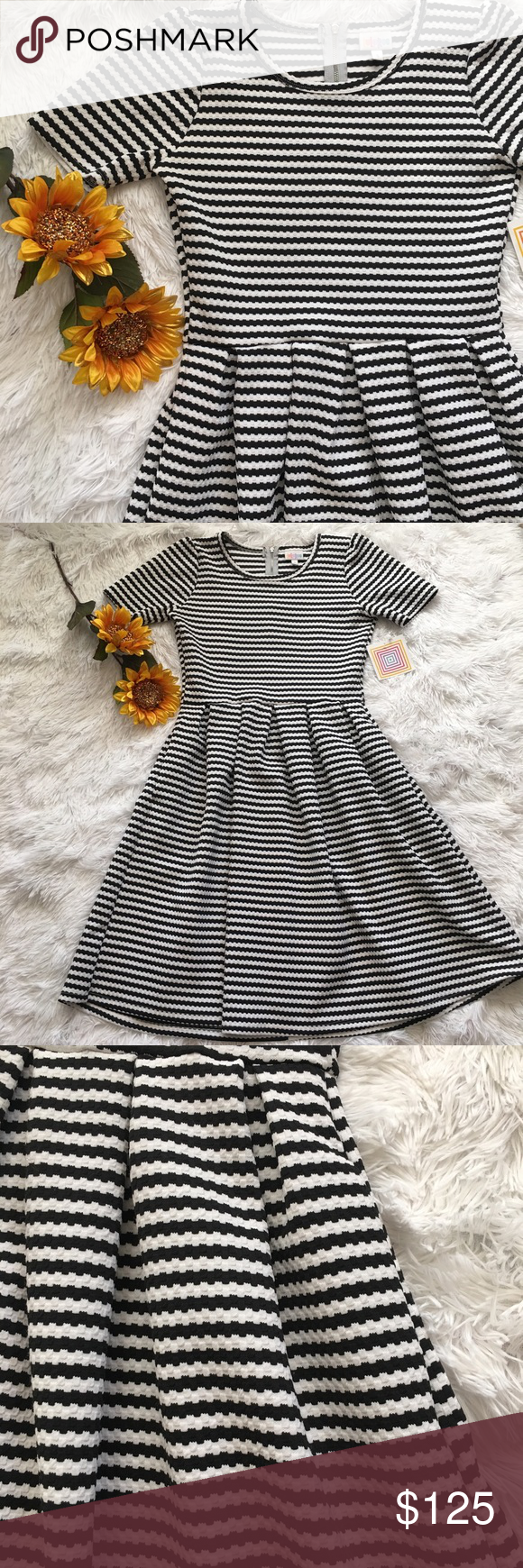 Lularoe Amelia vintage black & white stripes YOUR time is VALUABLE ⏳, so I have searched high and low for this limited edition, hard to find, rare unicorn treasure 🦄✨ This print symbolizes something you love ❤️  You WANT IT NOW, and here it is 🤗 💋Treat yo self 💐  💌please, no rude comments LuLaRoe Dresses Midi