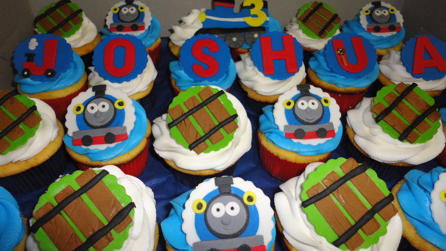 Thomas the train inspired edible cupcake/cake toppers. $18.00, via Etsy.