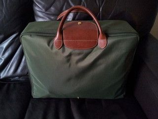 "Longchamp Pliage ""Valise"" : would love this in a bright color. Lightweight, practical, not pricey."