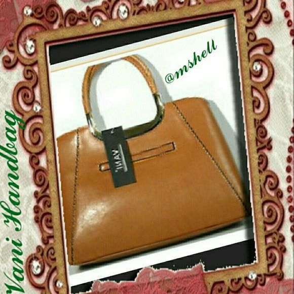 Vani Handbag Faux Leather With Shoulder Strap It Has A Small Pocket On The Back Does Not Have Very Large Opening Will Make Great Church