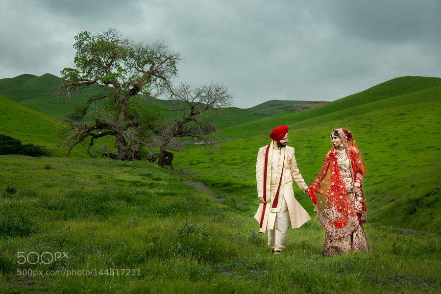 Indian bride in the fields by aperinastudios
