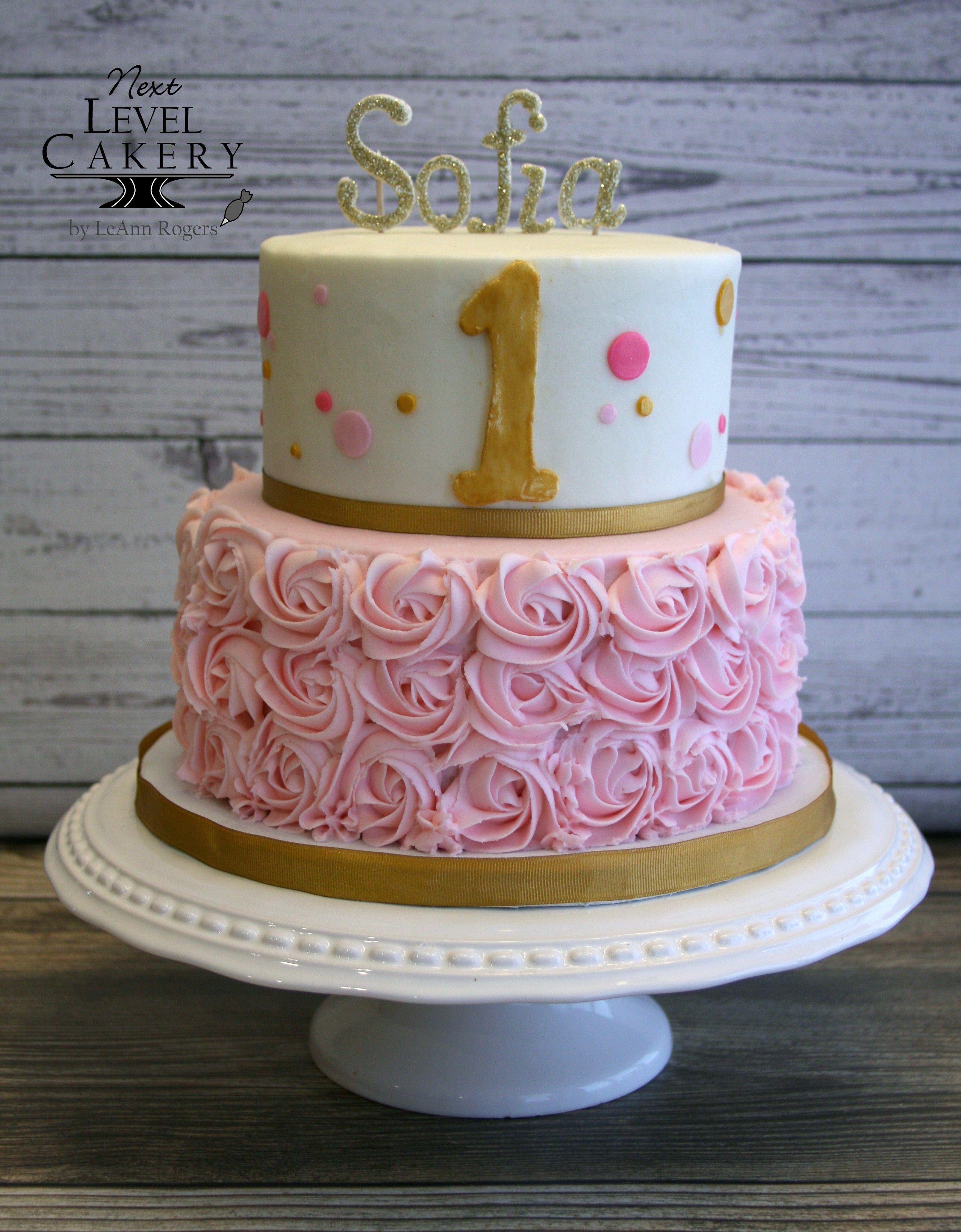 2 tiered cake pink and gold cake rosettes birthday