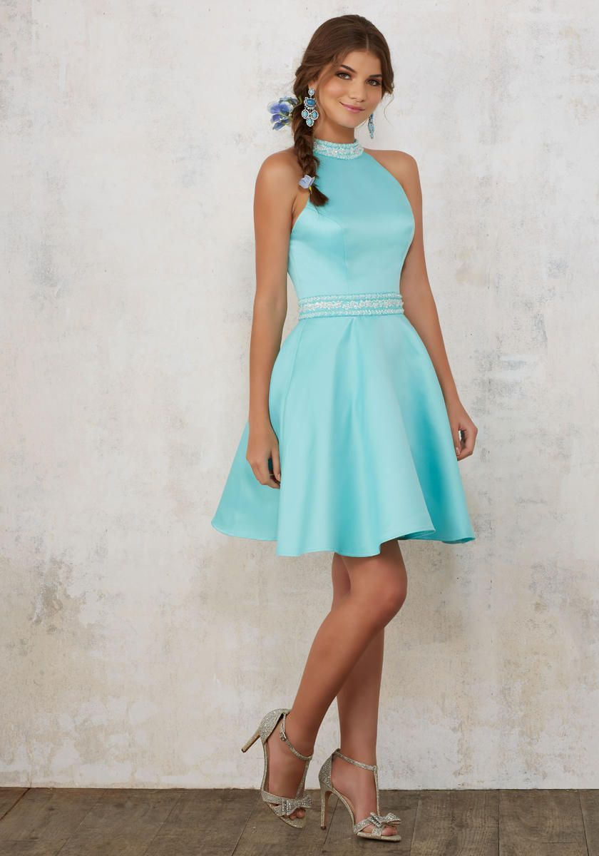 4ec31867991 Style 9445 from Sticks and Stones by Morilee Madeline Gardner is a high  neck satin cocktail dress with beading on the collar and waistband.