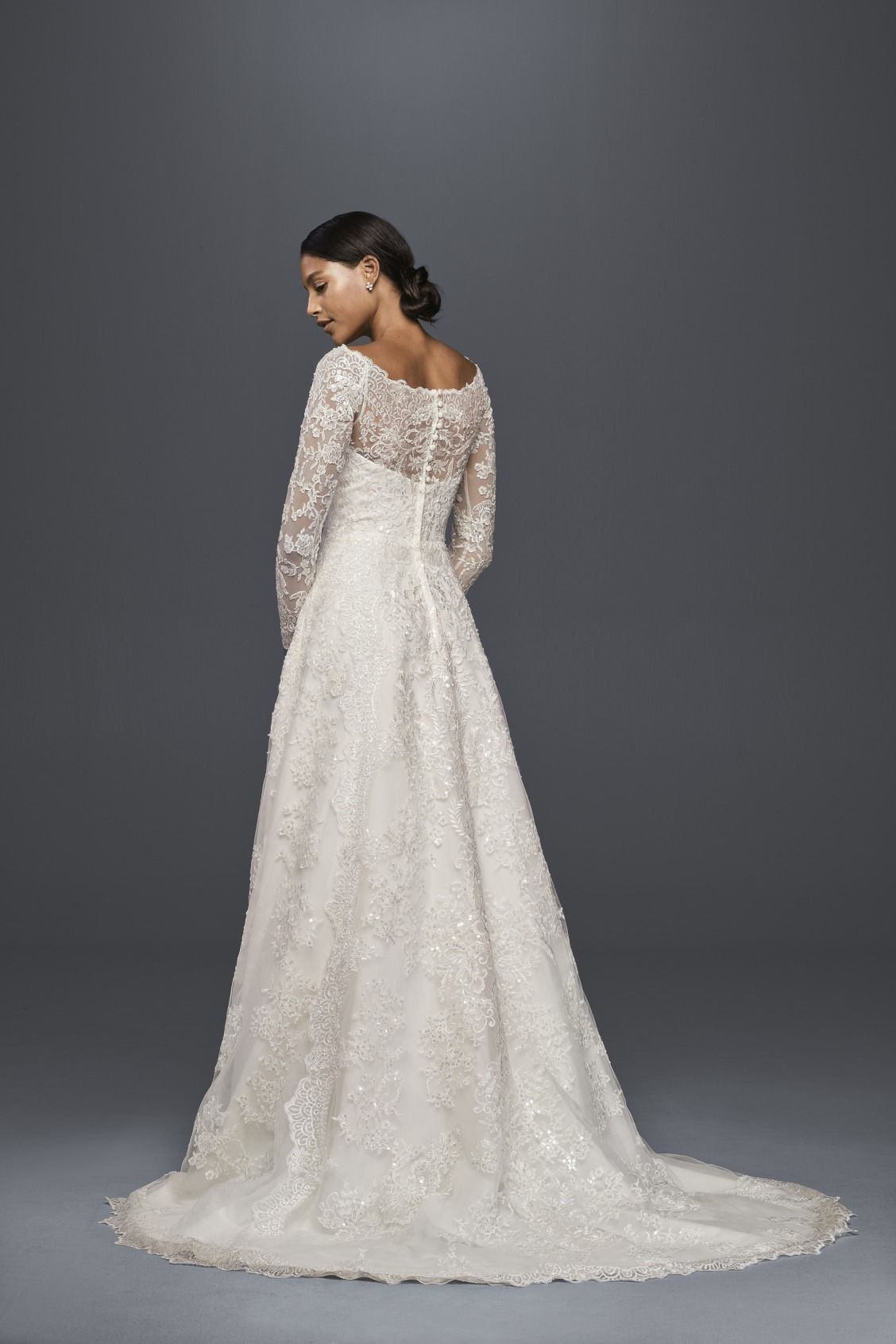 3766b31cab4 Beautiful all-over lace long sleeve a-line wedding dress by Oleg Cassini  available at David s Bridal