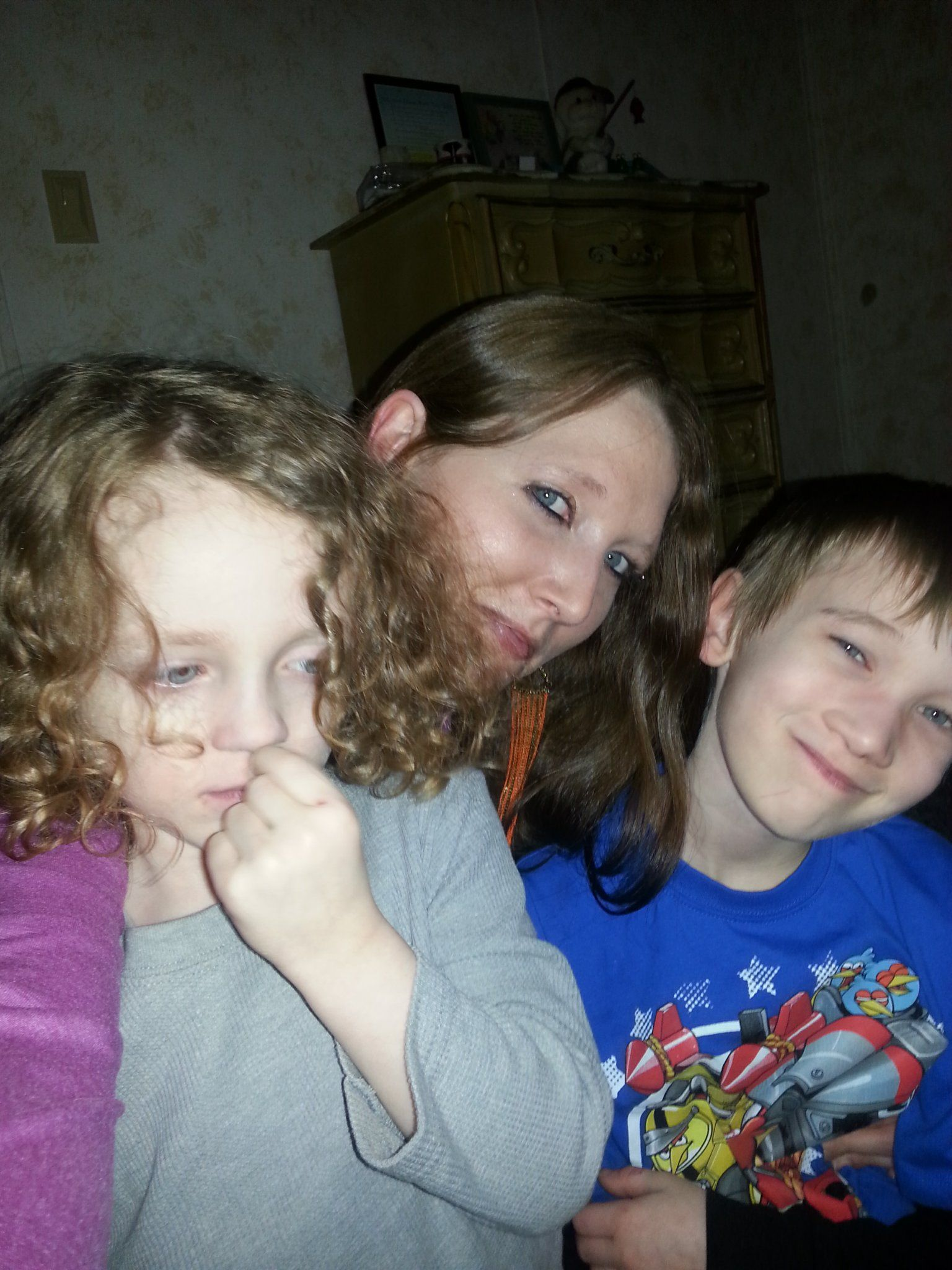 This is me w/my 2 boys on Christmas. Its my favorite pic bc I rarely get pics w/ my kids; they don't sit still long. I was happy they let me take a few pics even tho my youngest seems more interested in his nose haha. I love it bc it reminds me that it was our 1st Christmas in this home. We didn't get 2 have a big Christmas bc of financial issues, but it didn't matter bc we were all completely happy that day bc we were all together, happy, healthy, and having fun. It was a great day!