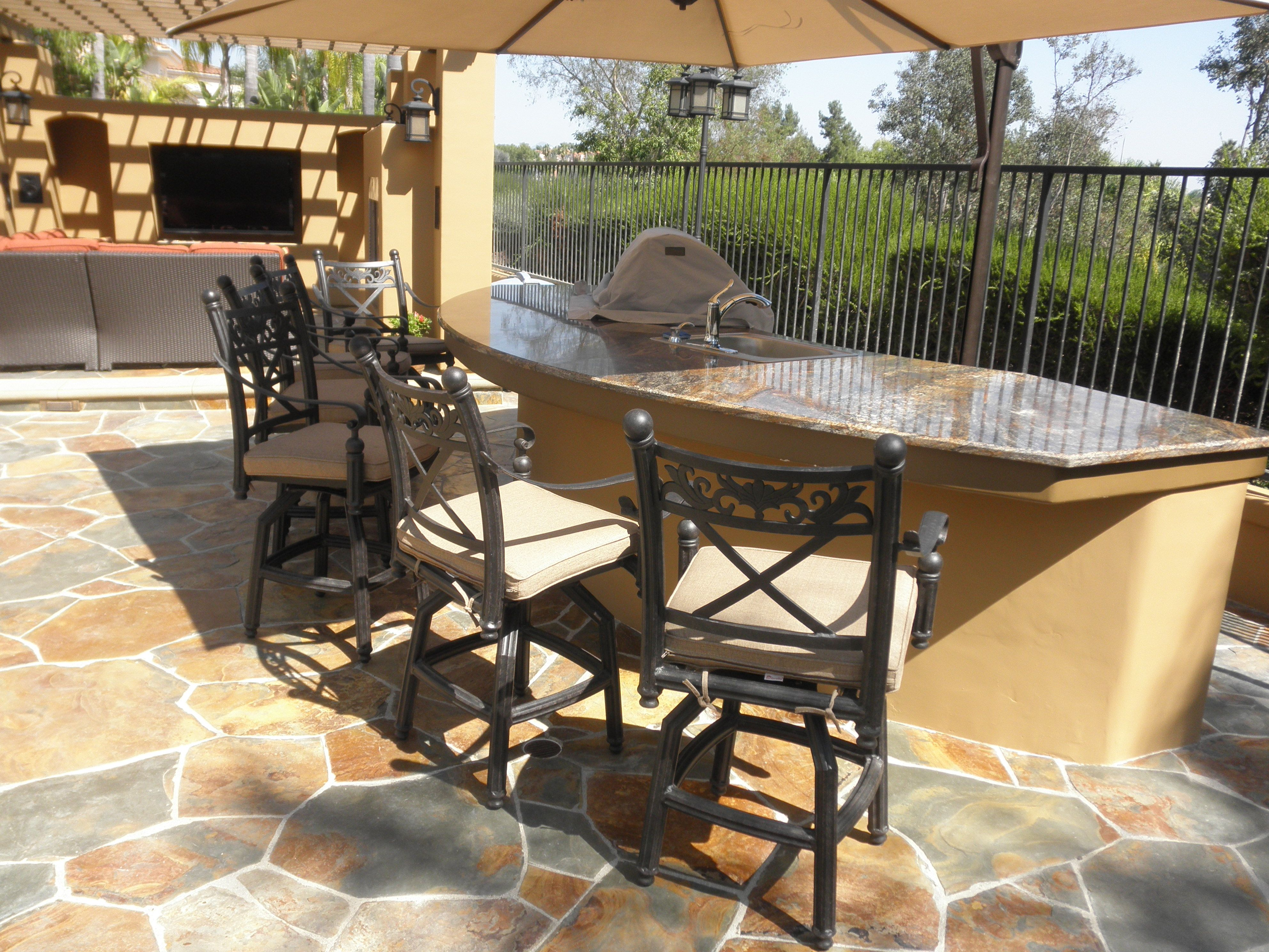 Outdoor Kitchen With Bbq Sink Refrigerator And Large Radius Eating