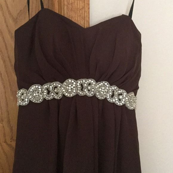 Chocolate brown hi low prom dress.  Brides maid? Perfect condition beautiful dress!  It is strapless. The stars u se in pic are just for hanging it up. Fiesta Dresses