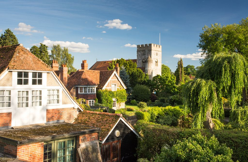 Reading, England, UK - August 29, 2016: Traditional cottages and parish church beside the River Thames in the village of Goring, Berkshire.