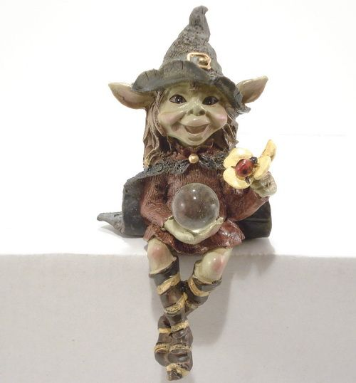 A goblin's name: Magician sitting on a shelf  Size: 12 cm