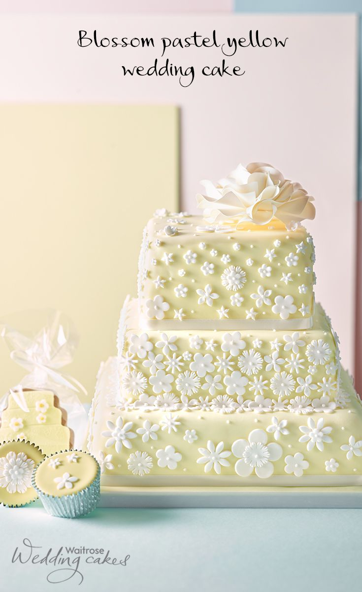 This beautiful floral wedding cake is covered in pastel yello ...