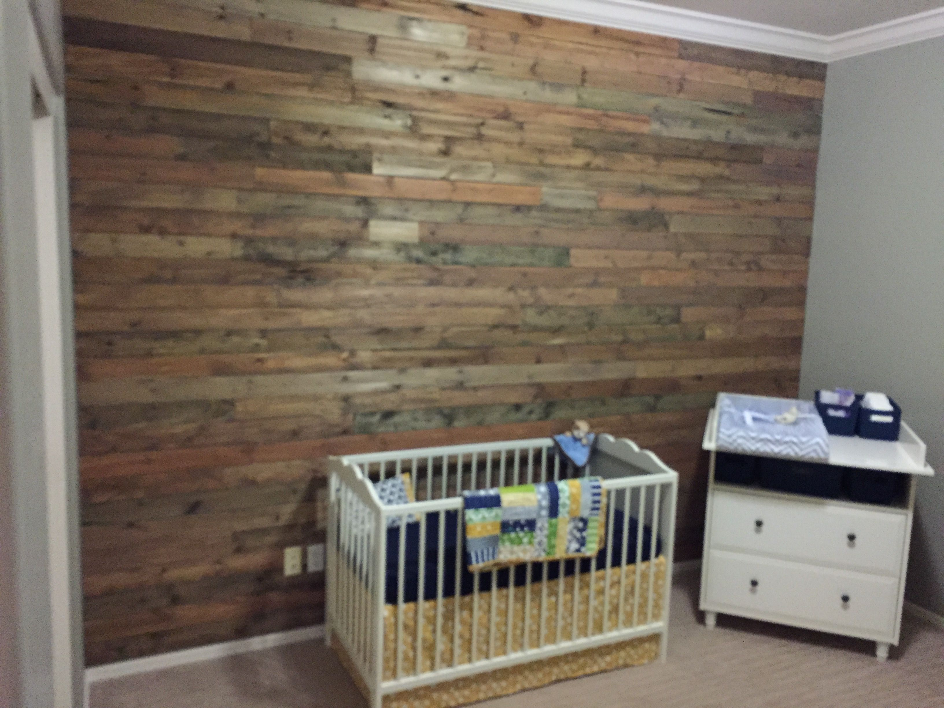 Plank wall completed for my nephew's nursery...great DIY that was actually fairly simple. Just stained and cut the wood then nailed it to the wall!