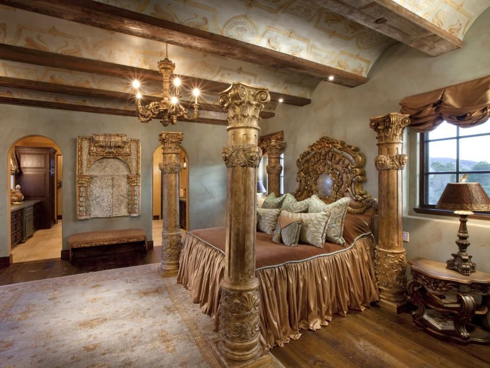This Ornate Master Bedroom Features An Elaborate Four Poster Bed Resembling  Roman Columns That Stretch Up