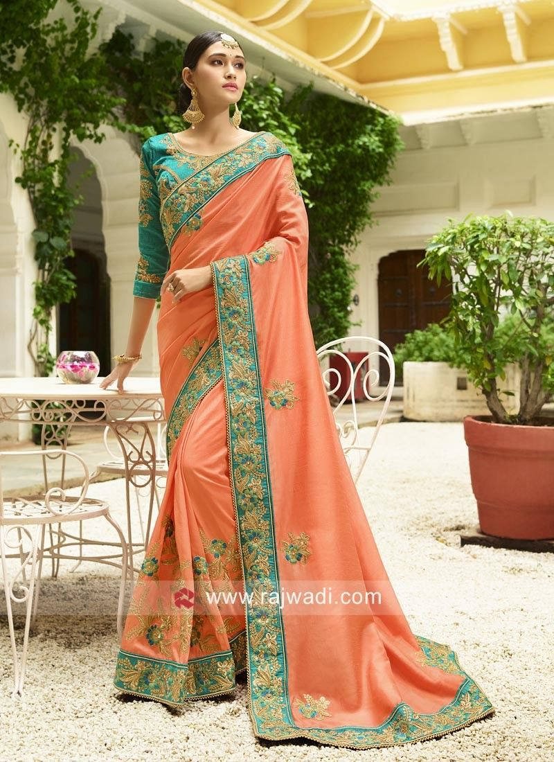 eb9bcdb2a30337 An adorable Peach Art Silk Saree is best for any occasion.Embellished with  embroidered motifs and has contrast border adorned with flower work on it.