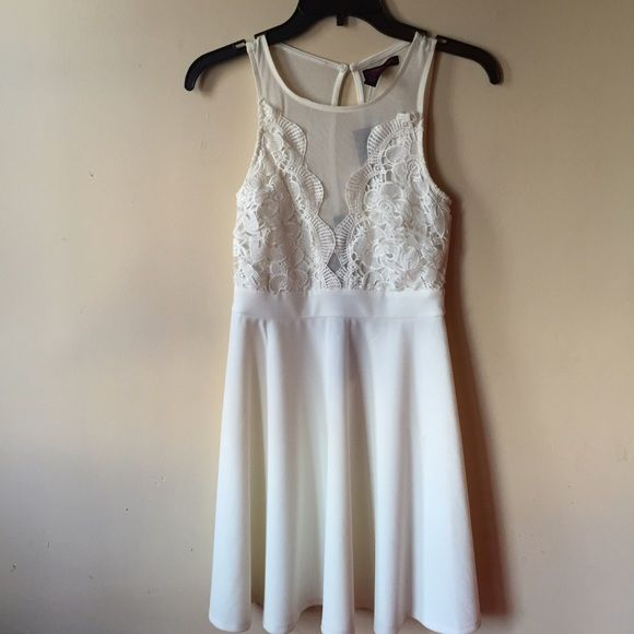 White dress with detail Very cute see through chested lace detail from material girl. Never worn Material Girl Dresses Midi