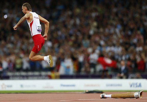 Poland's Lukasz Mamczarz starts his run up during the men's high jump F42 final at the London 2012 Paralympic Games. He won bronze in the event.