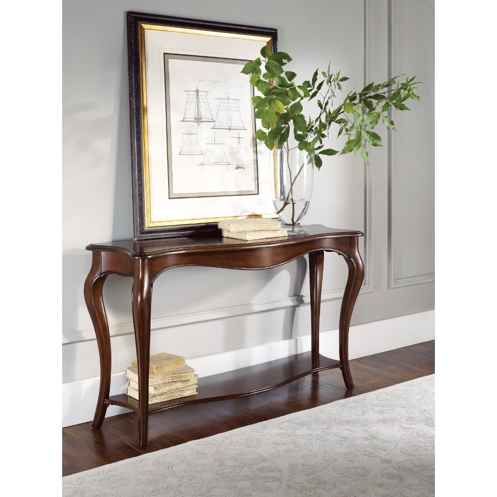 Try pairing a oversized print or painting with a classic console table from our popular Cherry Grove collection. Olive branches in a tall vase make the entryway cheerful and artfully stacked books complete the look. Find this console table at your local American Drew retailer: http://www.americandrew.com/findaretailer.cfm