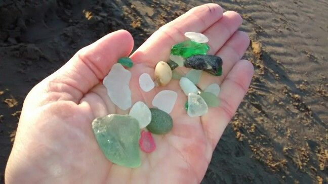 Sea glass from Rest Bay, Porthcawl.  The pink thing in the corner is a bit of plastic that's a nice shape!