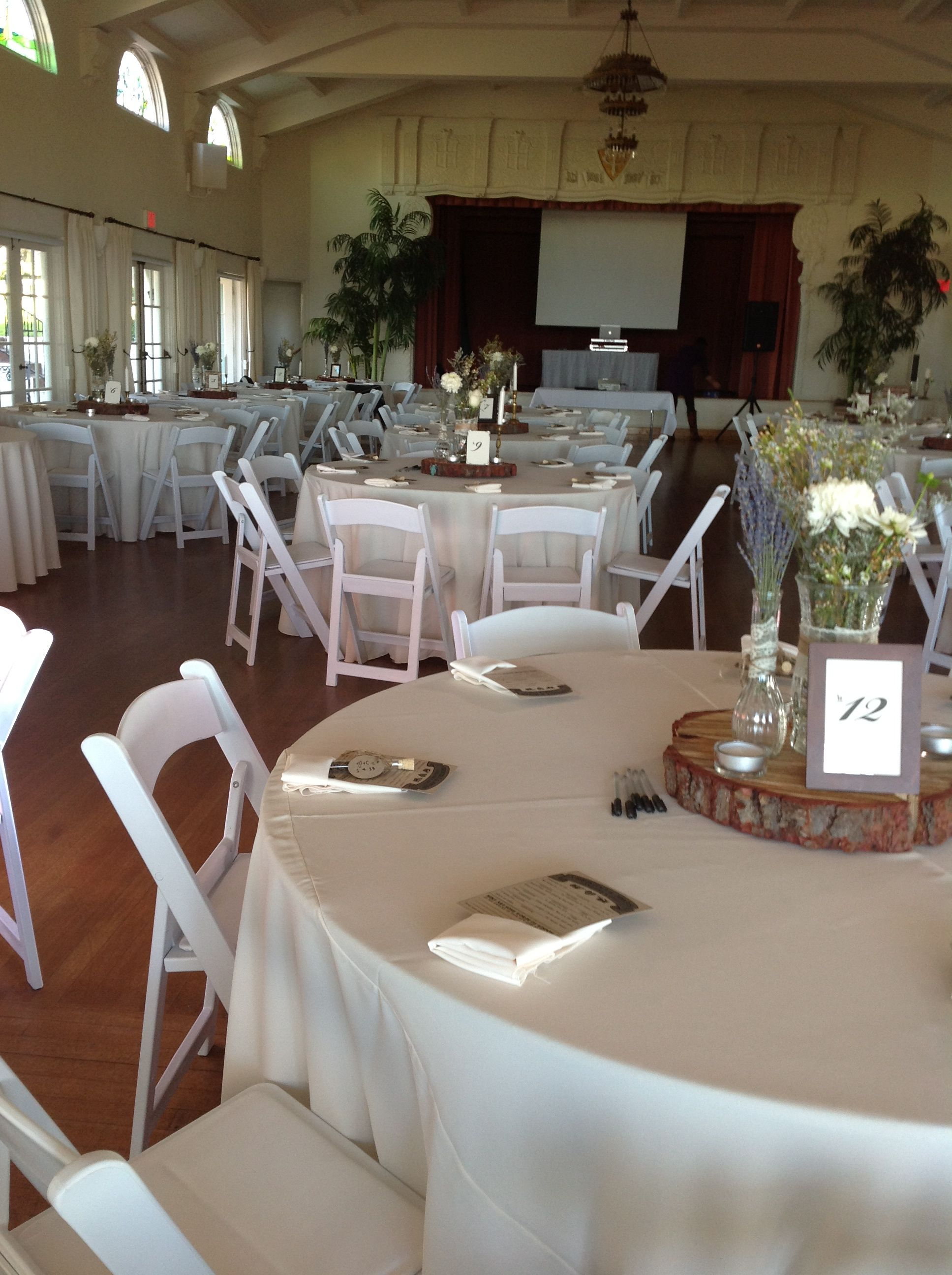 White Resin Chairs, Ivory Linens, and Ivory Napkins