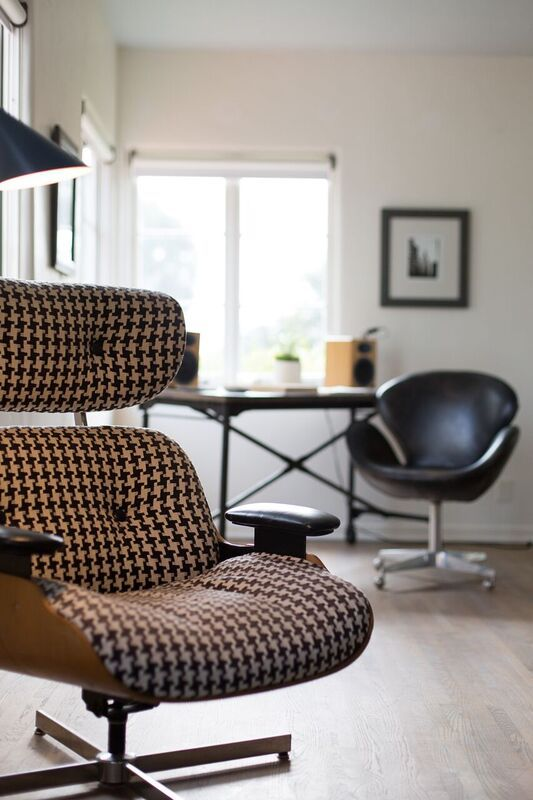 Original Eames Lounge Chair Upholstered In Houndstooth Fabric