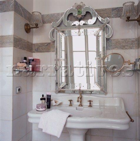 Amazing Venetian Glass Mirror Over Hand Basin In Elegant Tiled Bathroom