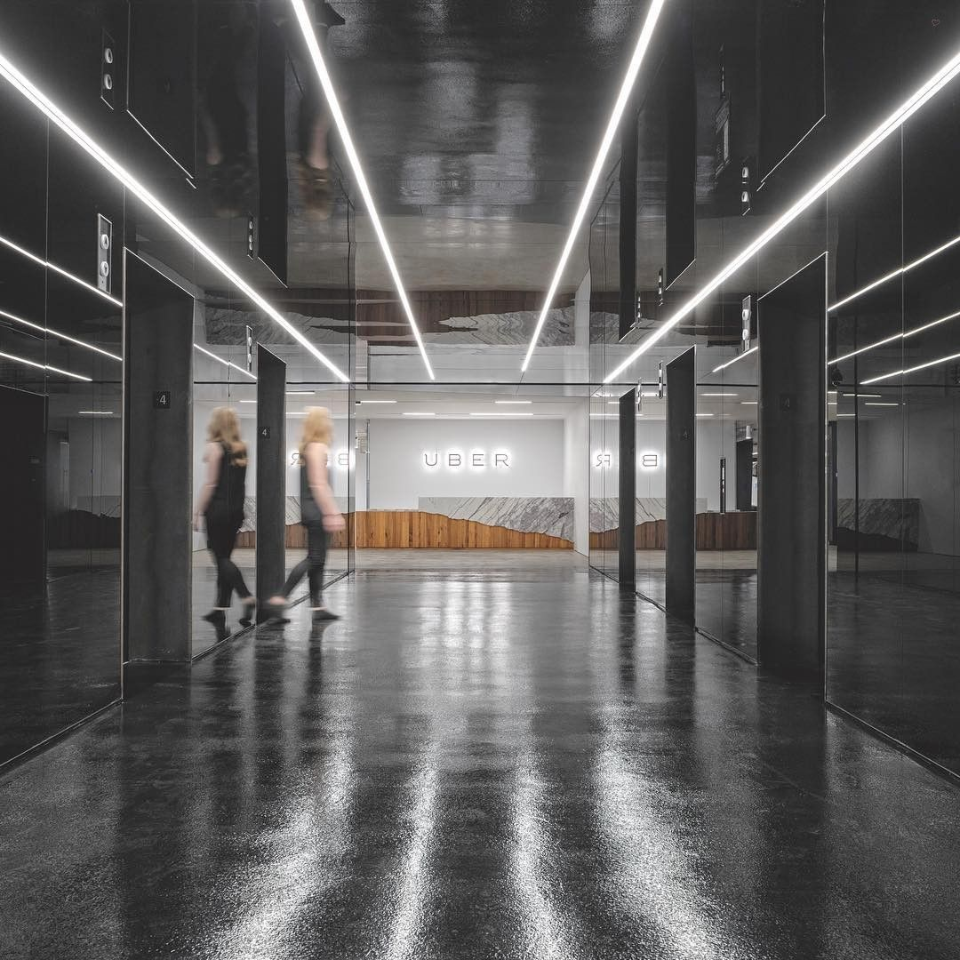 Tinted Mirror Walls And A Concrete Floor Coated In Epoxy Greet Visitors At Ubers San