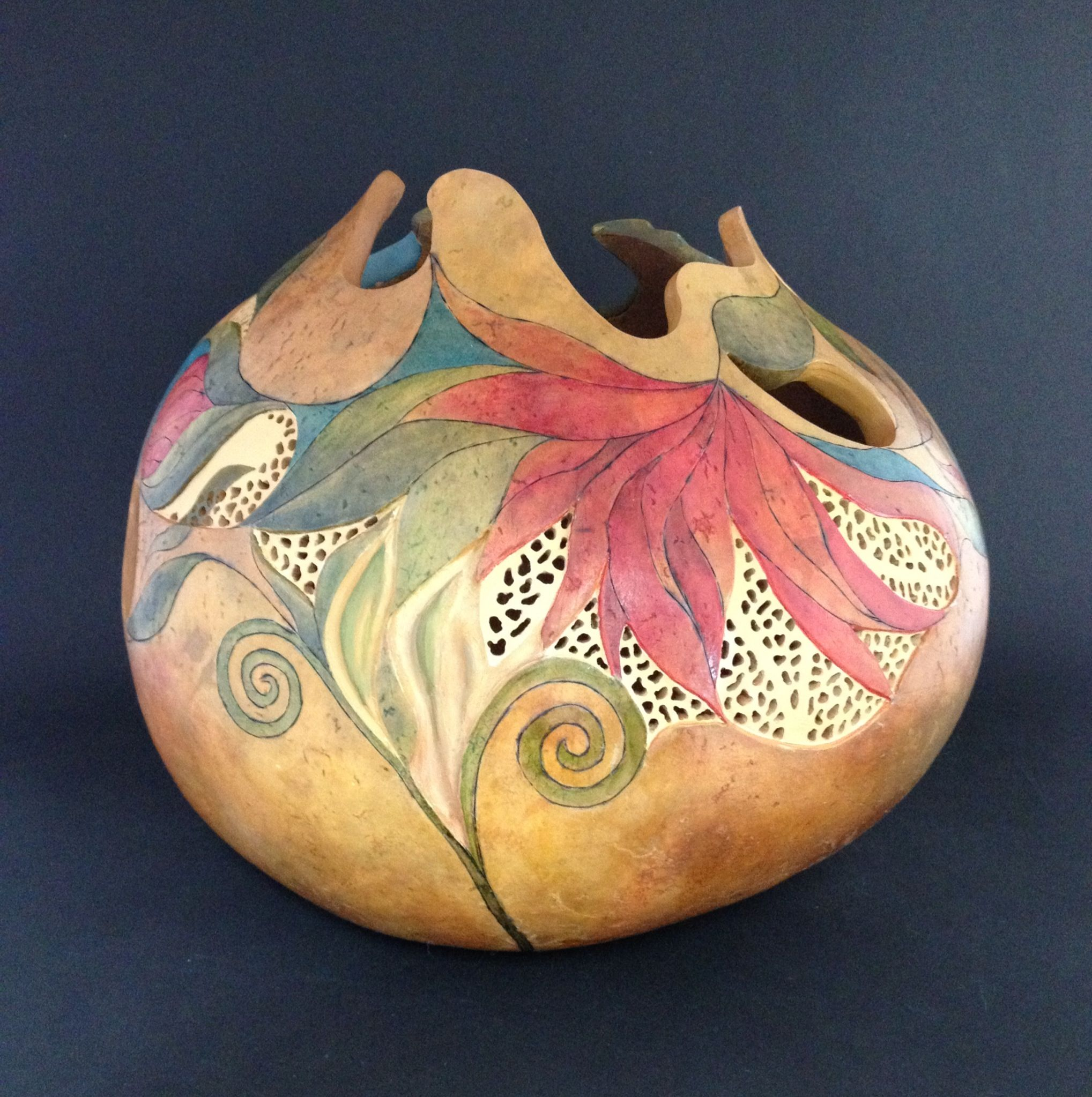 Floral expressions on a gourd. Fine gourd art by Mary Gehley