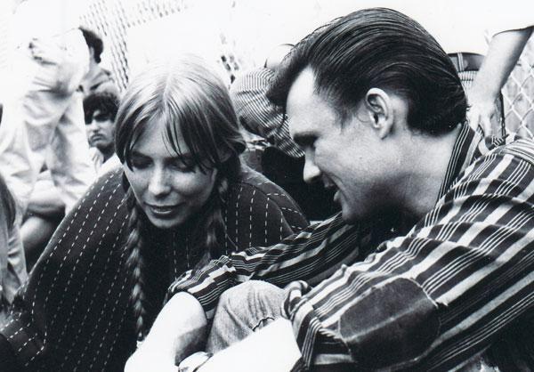 "Joni Mitchell and Kris Kristofferson at the ""Newport Folk Festival"" in (1969)."