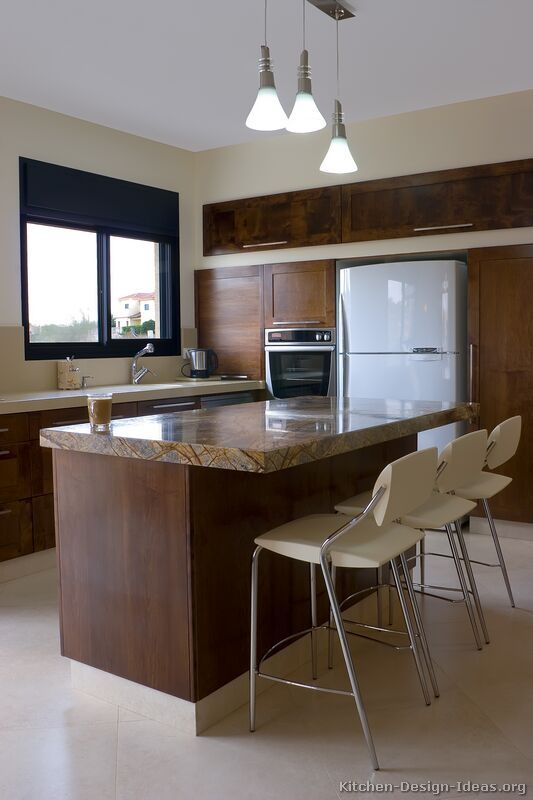 A Contemporary Open Plan Kitchen With Dark Shaker Cabinets