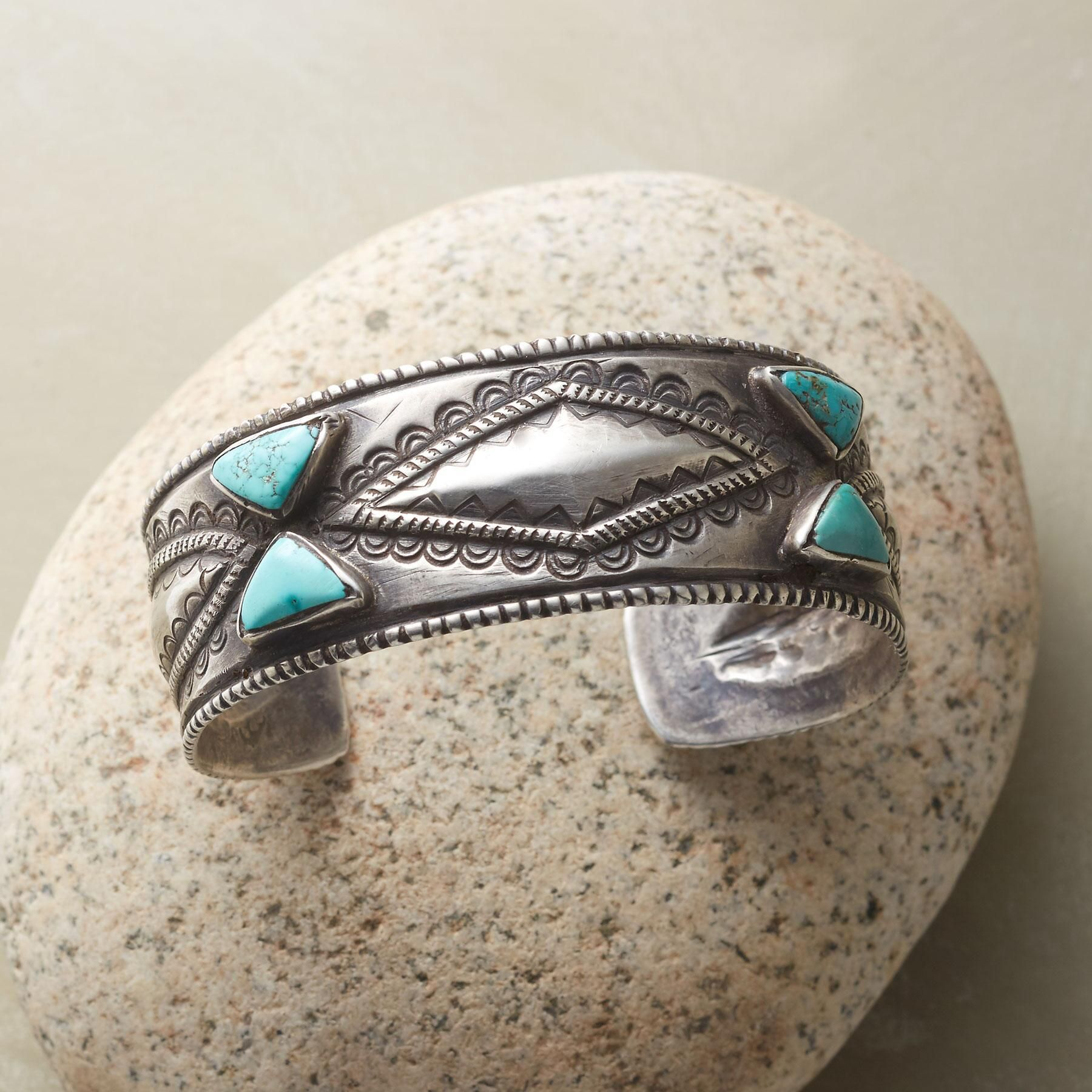 """SILVER DIAMOND FOX TURQUOISE CUFF -- Arizona silversmith Jock Favour highlights his one-of-a-kind cuff with triangles of green-blue turquoise from the famed Fox mine in Nevada. The cuff is hand forged in coin silver from melted pre-1964 coins, using the traditional Navajo ingot method, with hand stamping and repoussé work. Made in USA. Exclusive. 2-1/2"""" dia. 1"""" tapers to 5/8""""W."""