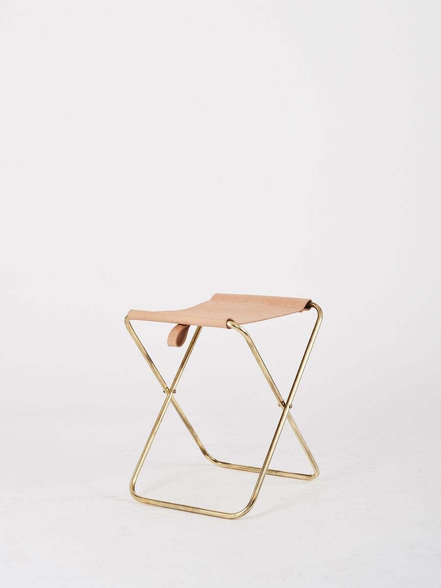 A lightweight living room or dressing table stool that folds away ...