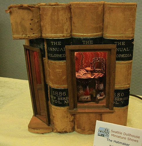"""The Hatmaker"" roombox built in a set of books exhibited by Kristine Hill at the Fall 2010 Seattle Dolls House Miniature Show."