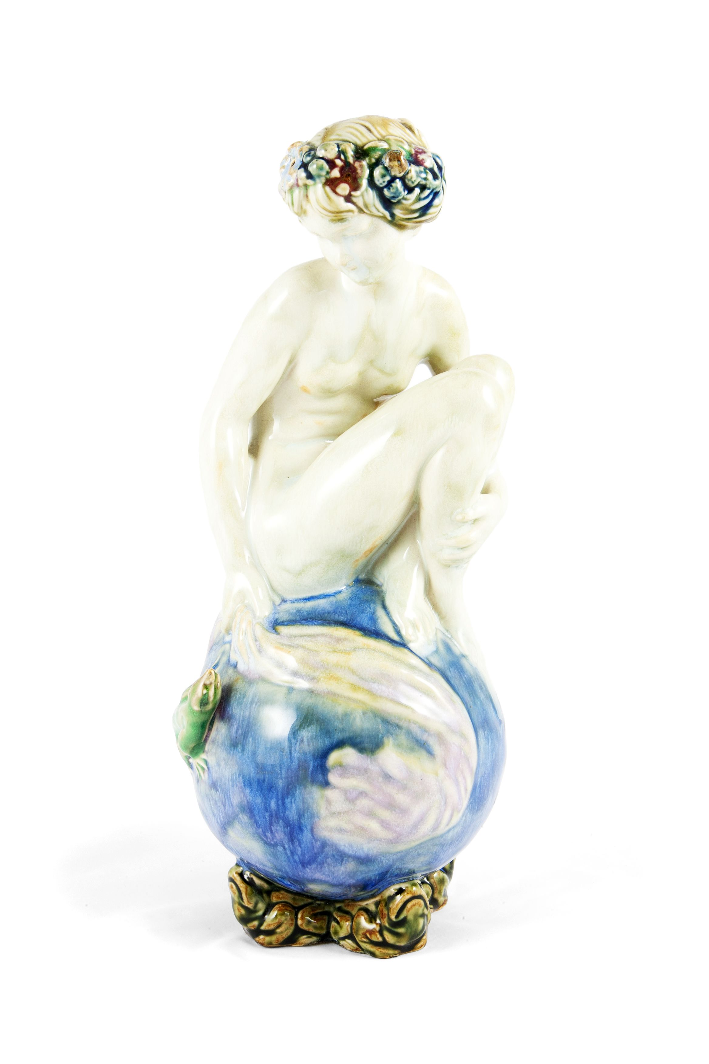 A beautiful Doulton porcellane figure representing a young girl having a bath and looking at a green lizard. C.1930