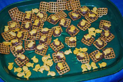 For nets full of fish Sunday School lesson. Snack- nets with fish made using waffle pretzels, hershey kisses, and goldfish. Place kiss on pretzel and melt the for a few minutes in the oven. take out and press fish into chocolate.