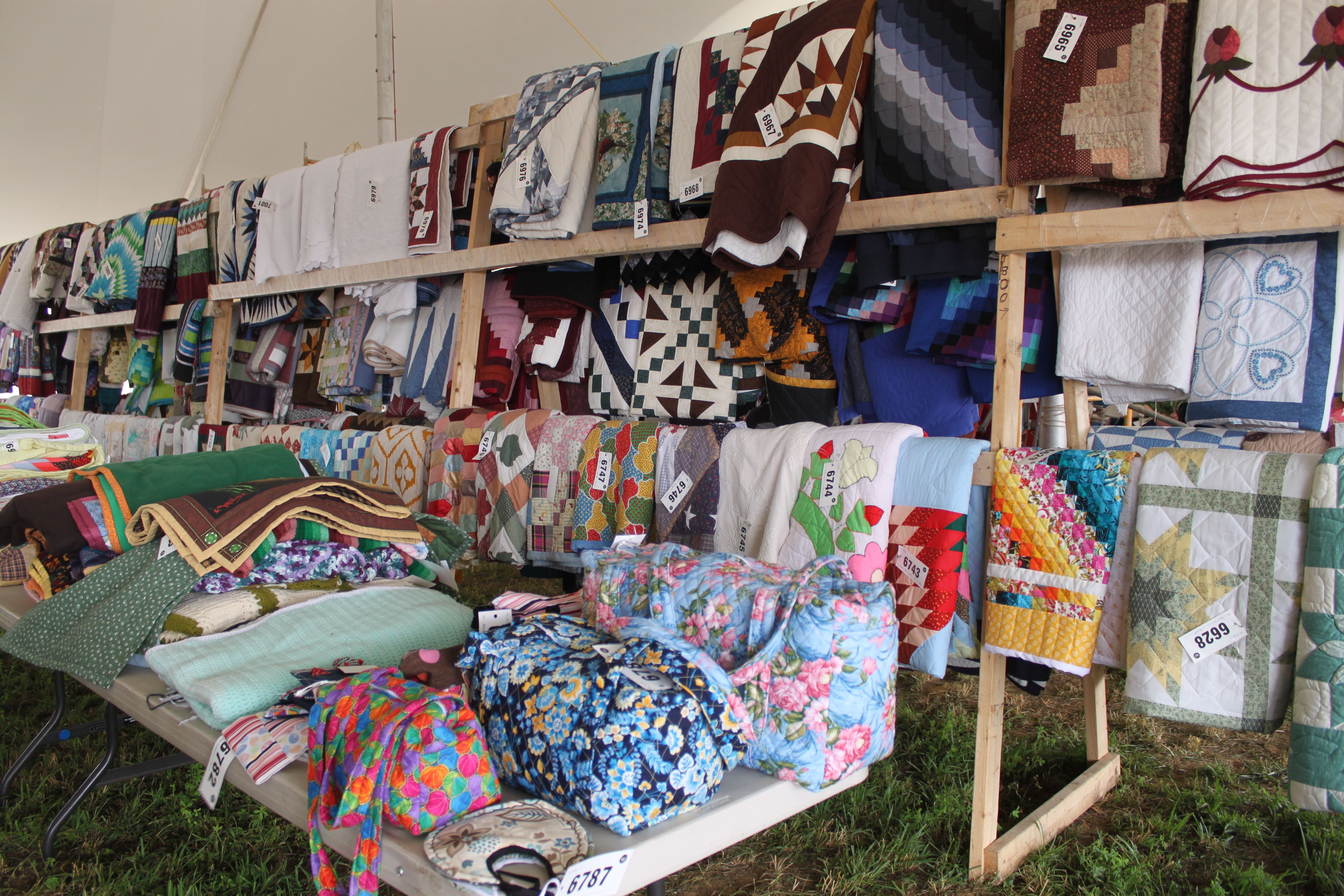 handmade quilts for sale near me amish quilts for auction at a summer mud sale near 3533