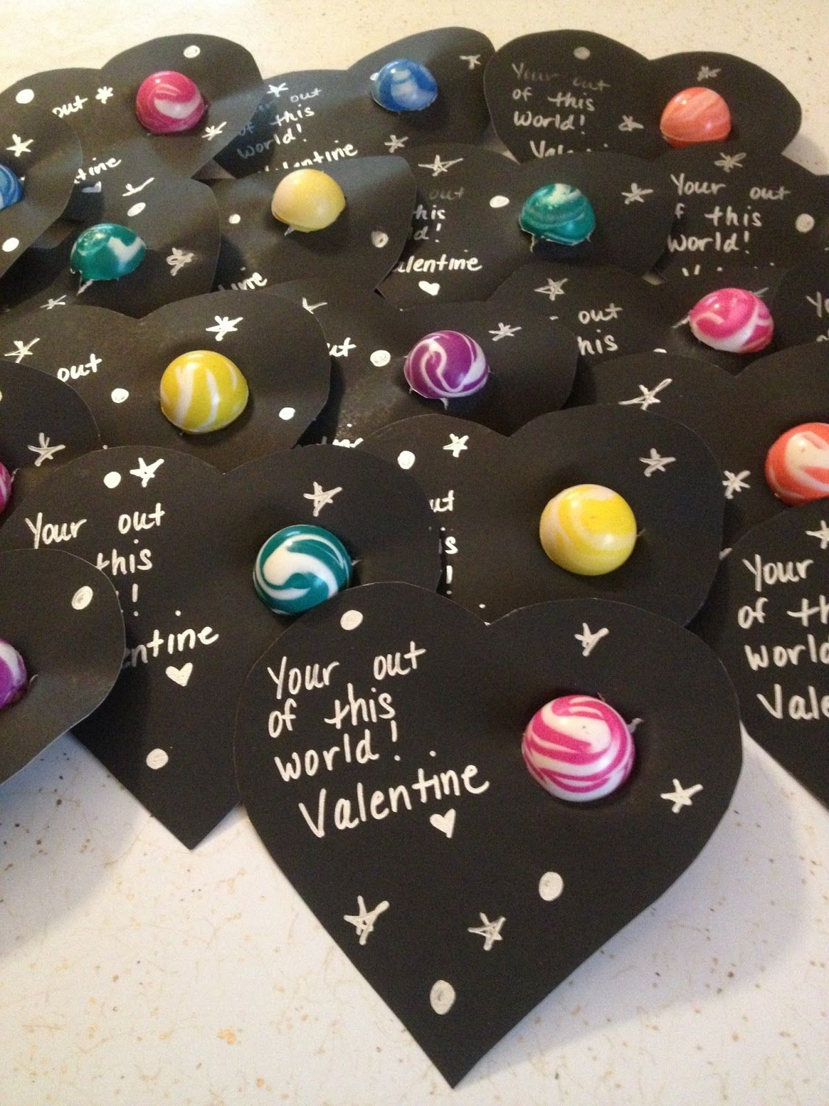 Black paper, gold or silver pen and bouncy balls from the party store.  What kid wouldn't love this Valentine. Note: you're = you are. C'mon people.