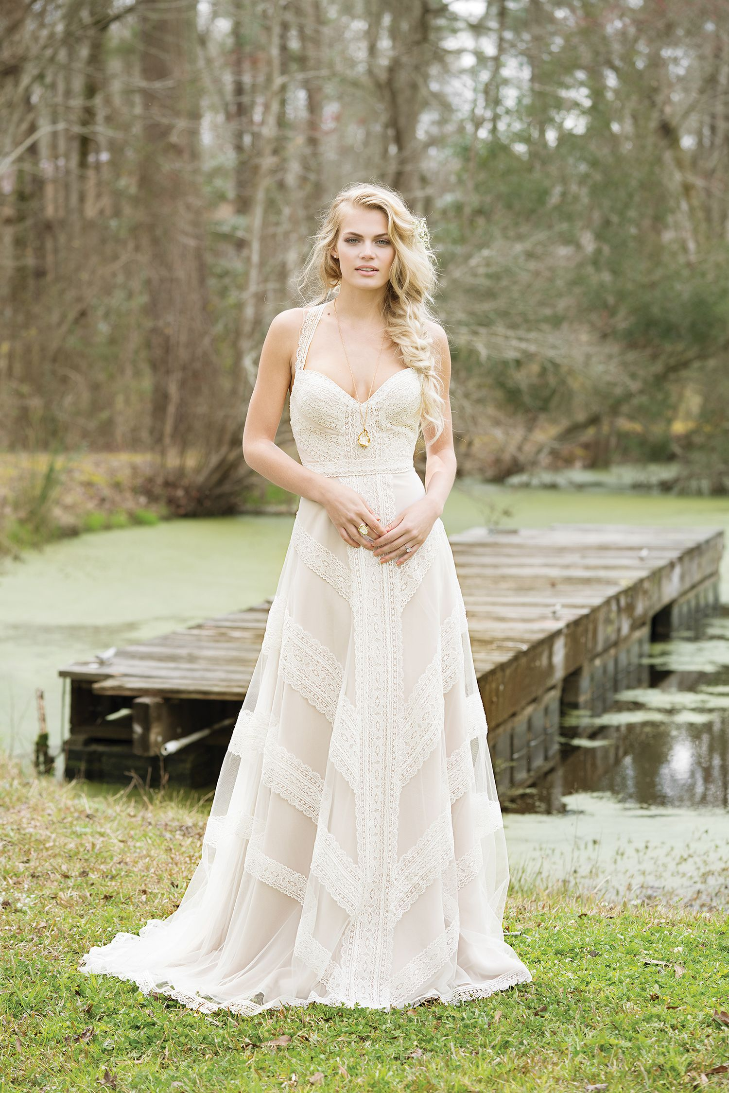 c633a4f07842 Crocheted lace creates a geometric pattern on this halter, racerback, A-line  gown with a beautiful hue and chapel length train.