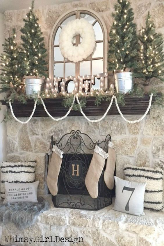 Neutral colors for Christmas decorations on fireplace and mantle - https://flipboard.com/@involvery/involvery-magazine-h6ihcm65y