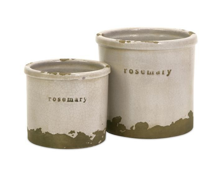 "Perfectly sized, this set of two rosemary herb pots is made of red clay and kiln fired to perfection. Material: 97% RED CLAY, 3 % SAND. 4.25-5.75""h x 5-6.25""d."