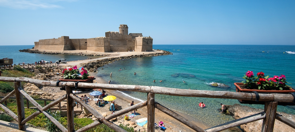 The old castle and the beach in Le Castella, a small