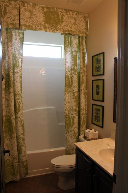 Shower Curtain Cornice Across The Top With Stationary Side Panels And An Extra Long Clear As Functional Part Of