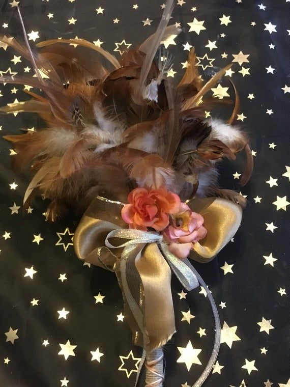 Gorgeous blend of brown feather smudge fan to help spread smoke from your smudge stick. Made with feathers, hemp string and Wiccan decor.